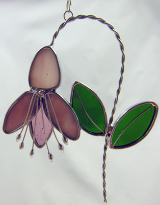 Fuchsia art glass suncatcher, pink flower with green leaves