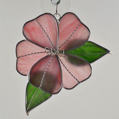 Pink hibiscus with green leaves art glass suncatcher