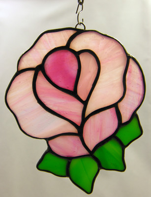 Pink blooming rose art glass suncatcher with green leaves