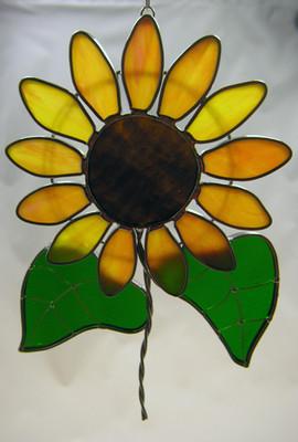 Sunflower art glass suncatcher in yellow, green, and brown