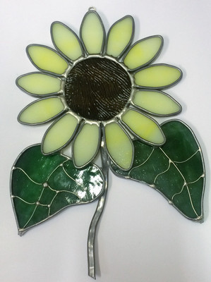 Large yellow art glass sunflower suncatcher with green leaves