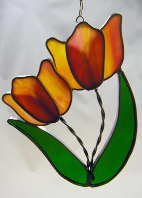Orange double tulip art glass suncatcher with green leaves