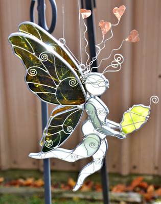 Botticelli inspired Earth Fairy art glass suncatcher in greens, browns, and yellows