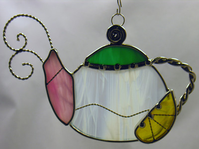 Teapot art glass suncatcehr in white, green, pink, and yellow