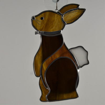 Standing art glass bunny suncatcher in brown and white opalescent glass