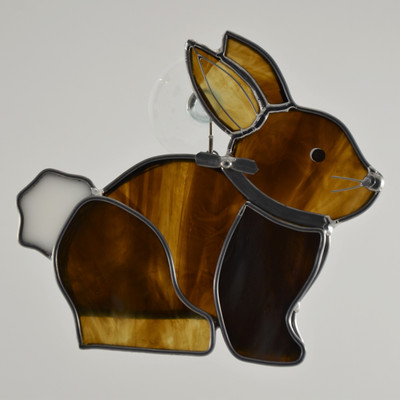 Sitting art glass bunny suncatcher in brown and white opalescent glass