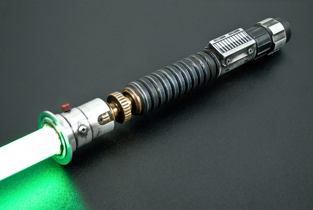 Lightly weathered Aurora Smart Saber® with red greeblie, silver control box and black standard switch.