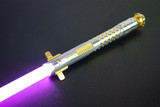 Pristine gold Allegiant Smart Saber® with a gold standard switch.