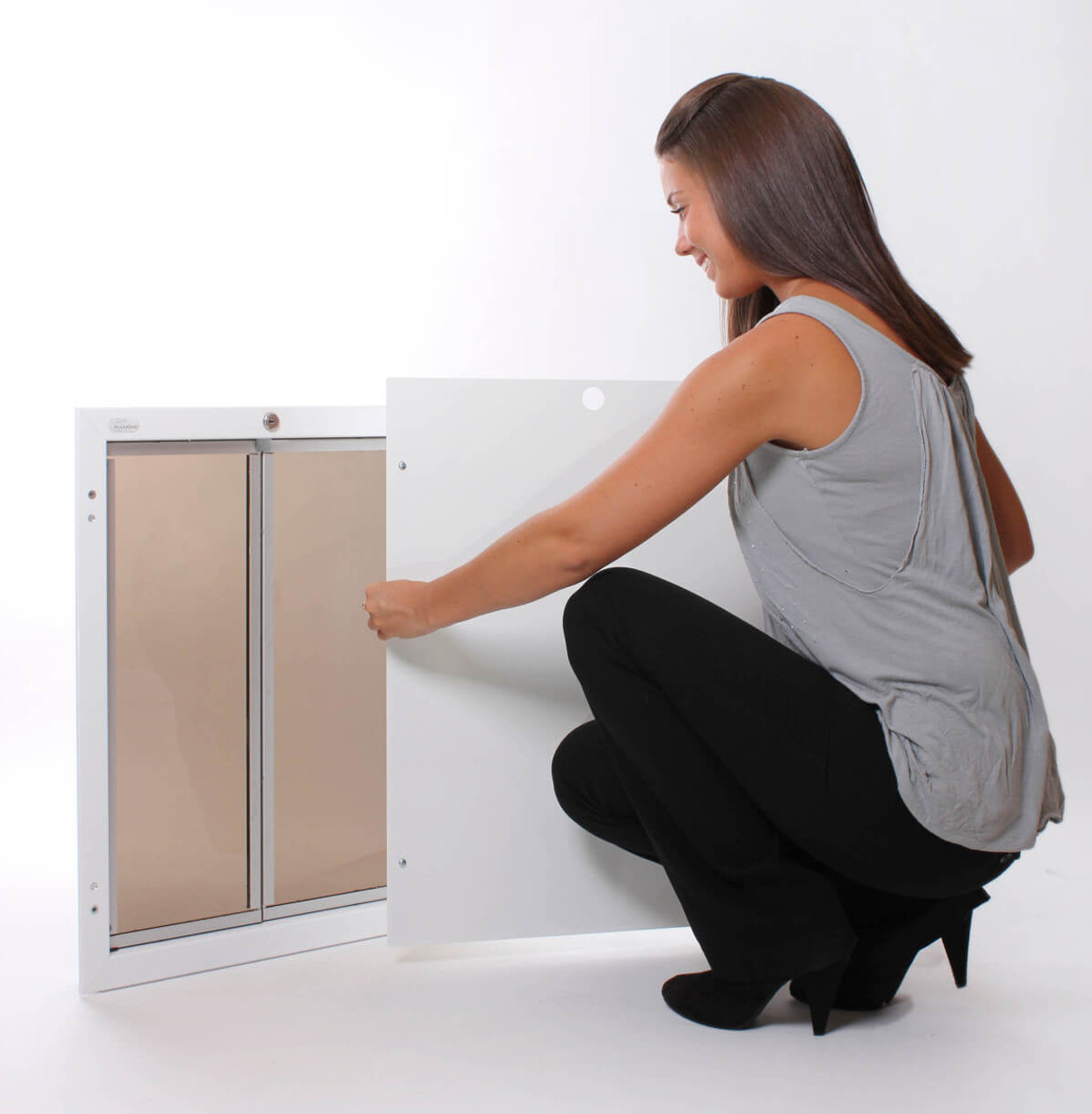 Plexidor dog door is one of the most secure with its steel cover which screws to the frame for a tamper resistant lock