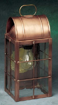 Arch Wall Lantern - Medium Shown with Antique Copper Finish, Seedy Glass and H Wire Cage
