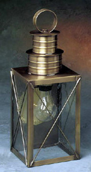 Williamsburg Wall Lantern - Medium Shown with Antique Brass Finish, Seedy Glass and X Wire Cage