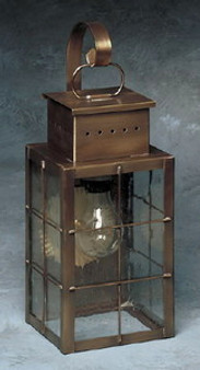 Pierced Square Wall Lantern - Mediium Shown with Antique Copper Finish, Seedy Glass, H Wire Cage and Arch Bracket