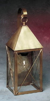 Pyramid Wall Lantern - Medium Shown with Antique Brass Finish, Seedy Glass, X Wire Cage and Arch Bracket