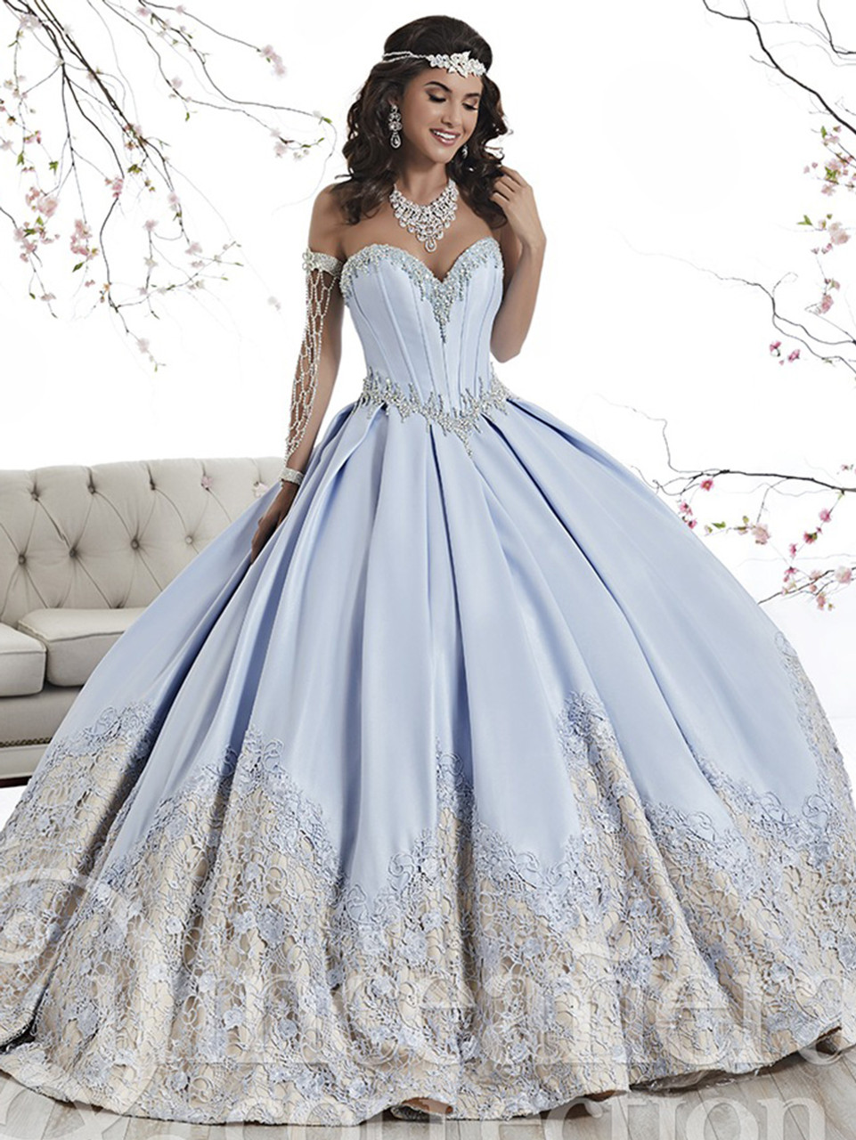 9762e1f7580 Blue quinceanera dress in satin with a spectacular lace hem