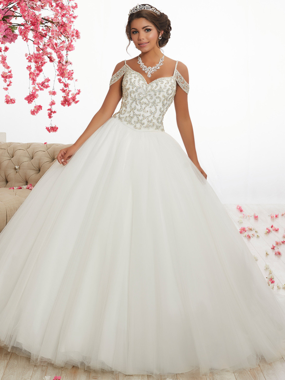 a734c267dbe8 white cold shoulder quinceanera dress with beaded bodice and traps that  ends in a full plain
