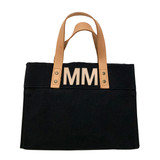 Black mini canvas tote with natural leather letter monogram