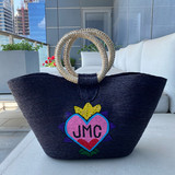 Black straw tote with heart monogram