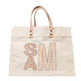 Natural canvas tote with matching leather block monogram