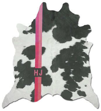 Black and white cowhide rug with custom monogram