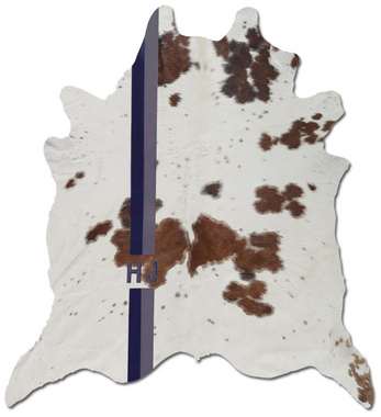 Brown and white cowhide rug with custom monogram