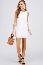 Because some styles never go out of style. Shot the summer-ready eyelet mini dress.