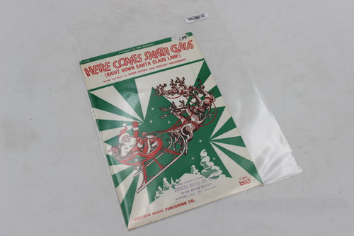 Western Music Publishing Co. Here Comes Santa Claus Words and Music by Gene Autry and Oakley Haldem