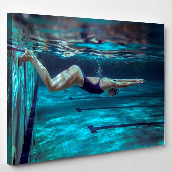 Underwater Female Swimmer In Swimming Pool - Sports And Recreation Canvas Wall Decor