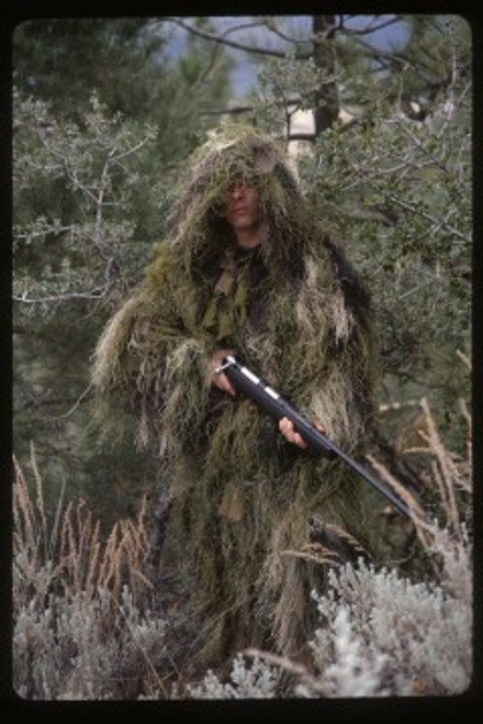 """Lightweight, Synthetic String Material Which Is Scentless, Hand-Washable, Non-Allergenic, Fire, Water and Mildew Resistant , The Shell For The Jacket Is Made Of A 3/4"""" Netting Allowing The User To Insert Natural Vegetation Or Any Additional Material To Alter The Camo Pattern , The Long Hooded Jacket Covers From Head To Boot , Sleeves Are Elastic Cuffed And Have Cord Locks , Does Not Include An Inside Liner Like The One Bushrag Sells Off Their Website , 100% Polypropylene"""