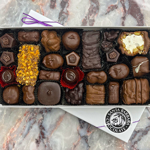 Sugar free chocolate candy box with gourmet sugar free chocolates, sugar free chocolate truffles, sugar free toffee, sugar free caramel, sugar free chocolate clusters and sugar free creams.