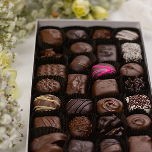 Mother's Day Chocolates are an assortment of soft chocolates. Truffles and creams are handmade and decorated to offer an idea of each chocolate flavor hand packed in the Mother's Day gift box. Stack the chocolate boxes we offer to make a Mother's Day Gift Basket of chocolate.