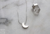 Silver Crescent Moon Necklace at BLK AND NOIR