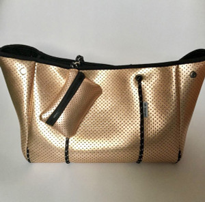 Classy and Comfortable. This Gold Neoprene Tote  travels everywhere you do!
