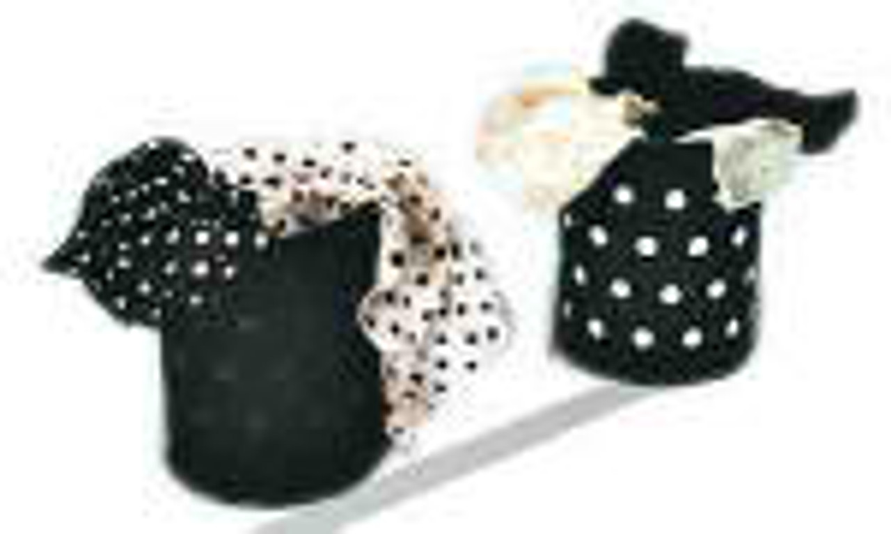 Transform from a spotted tin to a blank tin as the spots magically move from the silks!