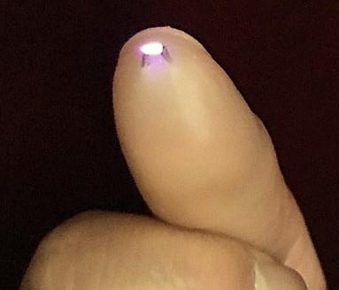 electronic-thumbtip-lighter-magic-trick-3.jpg
