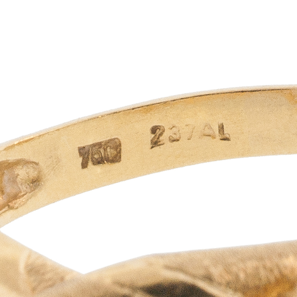 The Italian Mark for 18 kt Gold and Possibly a Serial Number Stamped on the Inside of a Gold Snake Ring