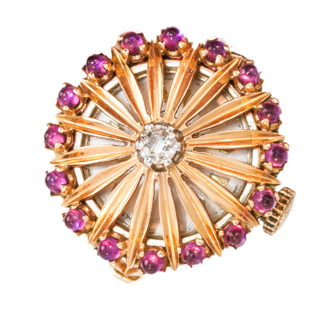 A Vintage Rose Gold, Diamond and Ruby, Cocktail Watch Ring from the 1950's.