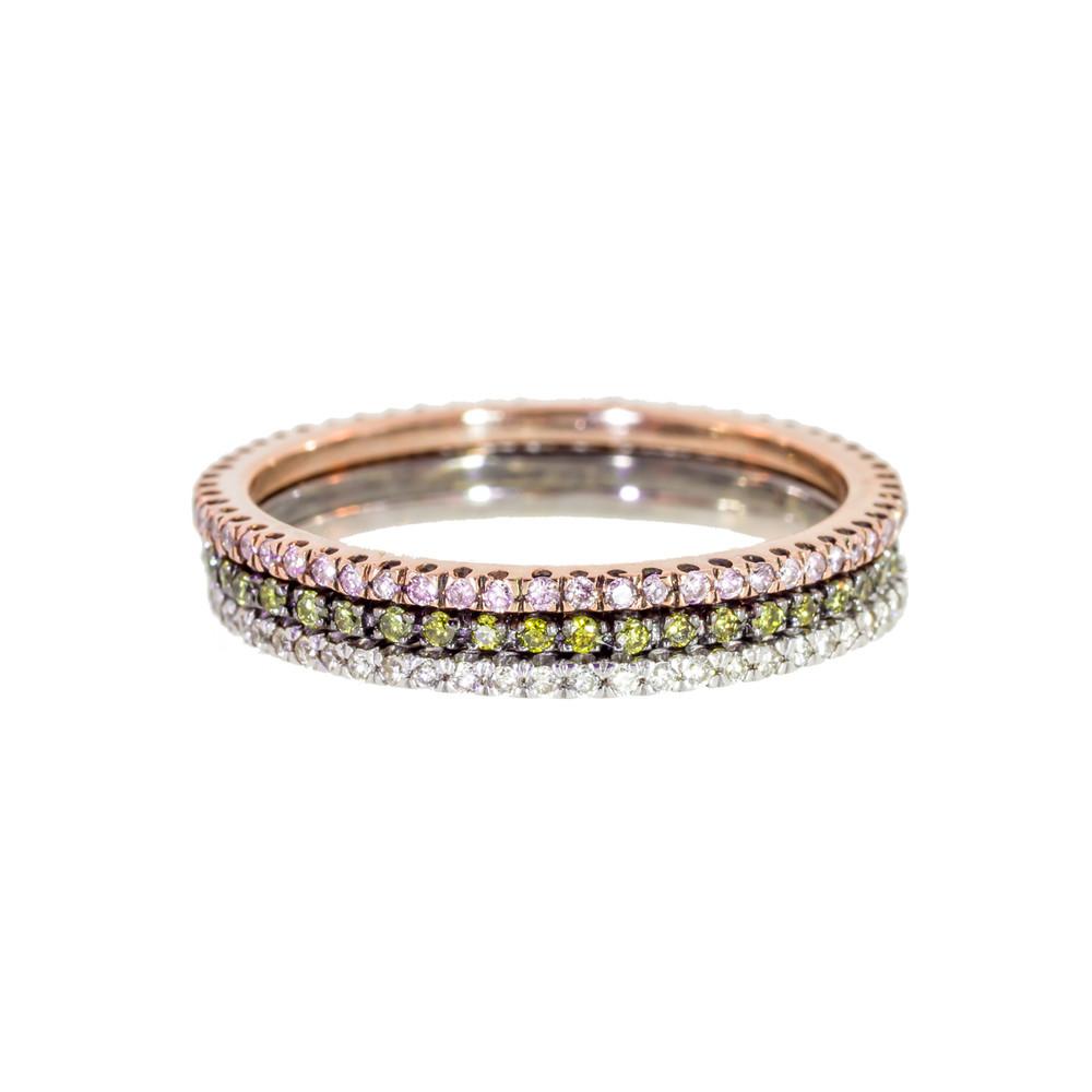 Diamond stacking rings with pink diamonds and green diamonds.