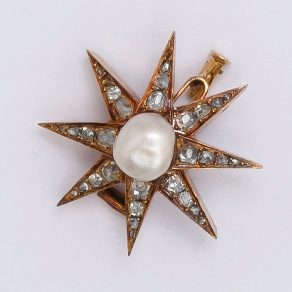 French 19th century diamond star brooch with Old Mine Cut Diamonds