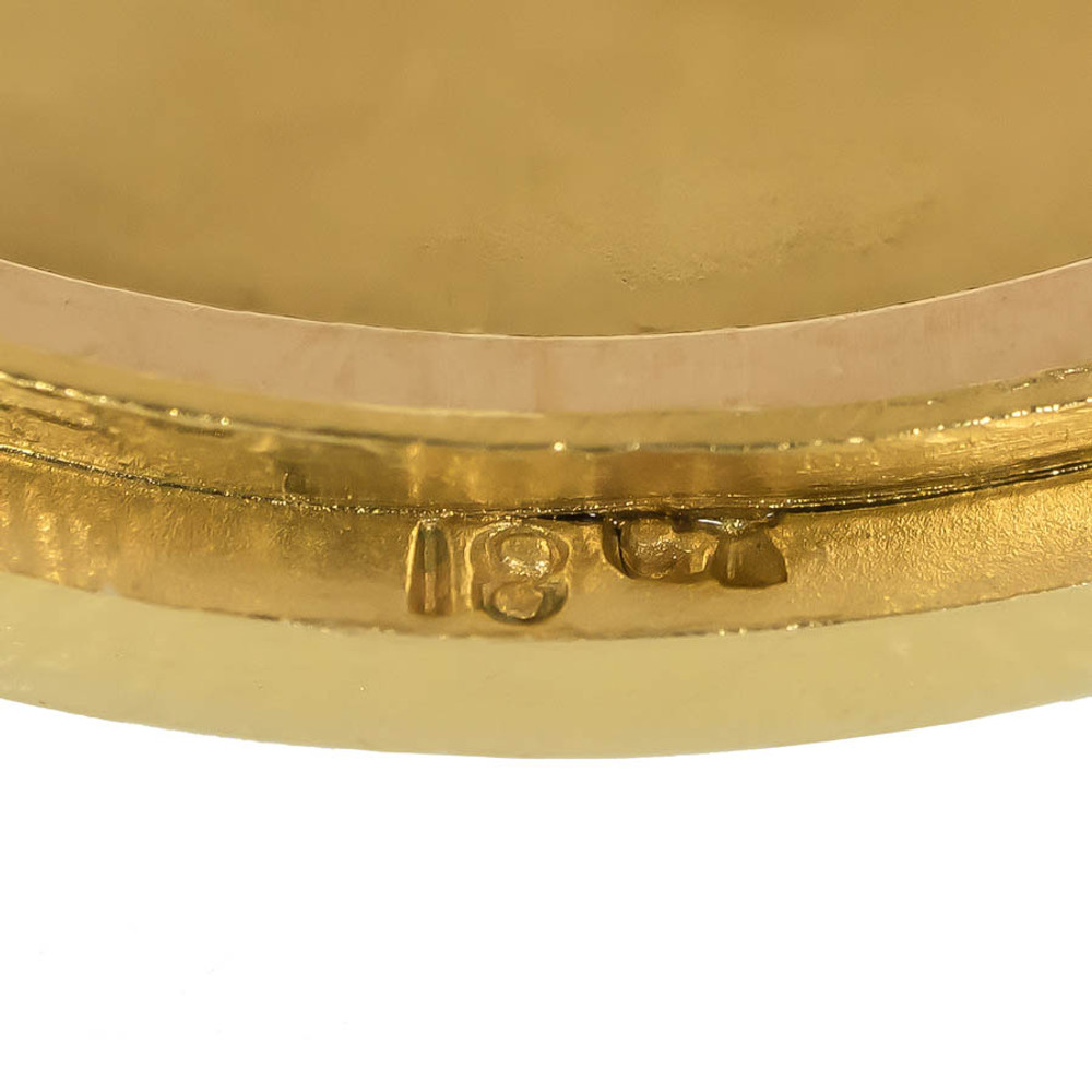 An antique gold locket with an 18 ct gold mark.