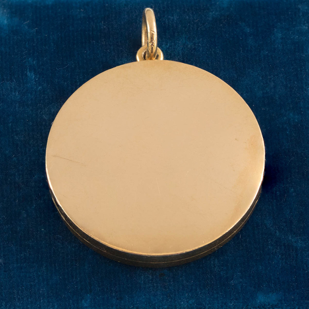 An Antique 18kt Gold Heavy and Thick Locket