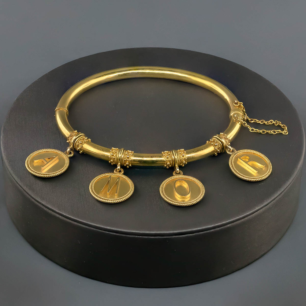 Gold Bracelet with Charms that Spell Amor or Love in 18 kt Gold