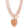 Antique & Modern:  Double Strand of Pink Pearls with Antique Rose Gold Shield Locket