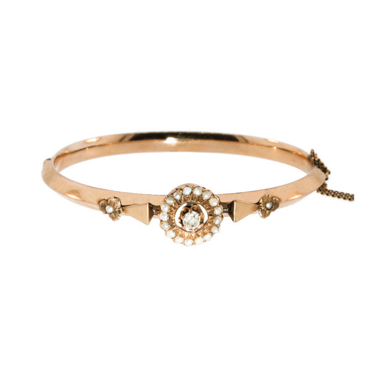 An Antique Gold Bangle with a Old European Cut Diamond and Seed Pearl Flowers