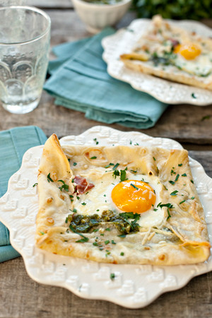 BAKED GREEN EGGS WITH PROSCIUTTO AND PESTO