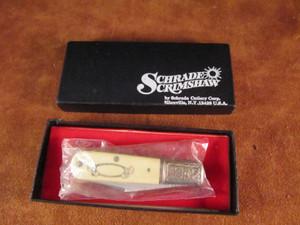 Schrade USA scrimshaw SC 506 Racoon