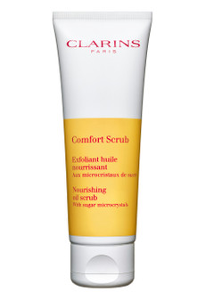 Clarins Comfort Scrub is a nourishing oil scrub with sugar microcrystals, which gently removes dead cells and provides comfort to dry skin. This enveloping gel-in-oil texture, transforms into a milky veil on contact with water. The featured ingredient of wild mango butter helps smoothes skin texture, provides comfort and illuminates the complexion. Use once to twice a week on clean, dry skin, massage in gently without rubbing or pressing. Rinse. Can be also applied to the lips.