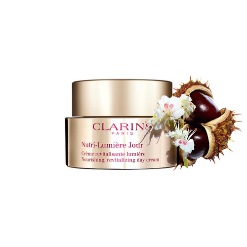 Clarins Pro-Aging Nutrition Innovation. Clarins Laboratories has developed a pair of potent active ingredients that put the radiance back into your skin. The organic flower extract and ecsin (active molecule in the fruit) from the horse chestnut tree are known to affect the micronutrient network. A product of Clarins Laboratories expertise, this invigorating duo maximises the penetration of nutrients in the skin. Your skin is better nourished and its radiance is restored. A joy for the senses, Nutri-Lumière Day Cream is the ideal melting cream-in-oil for revitalising, intensely nourishing and restoring radiance to undernourished skin. Suitable for all types of skin.  Revitalises Intensely nourishes Restores the skin's radiance