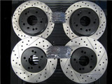 Package - STOPTECH Drilled & Slotted Rotors with STOPTECH Ceramic Pads and Stainless Steel Brake Lines - Front and Rear