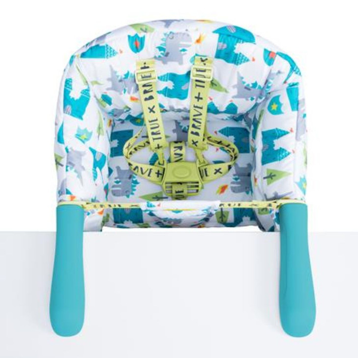 Cosatto Travel Highchair - Dragon Kingdom attached to table.
