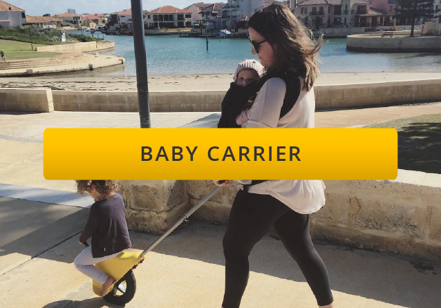 woman carrying a child in a baby carrier